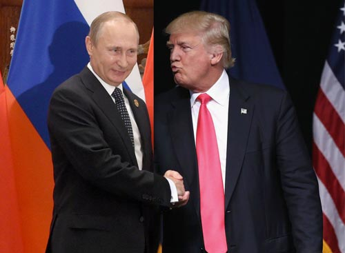 (L) Russian President Vladimir Putin in a handshake with U.S President Donald Trump (R)