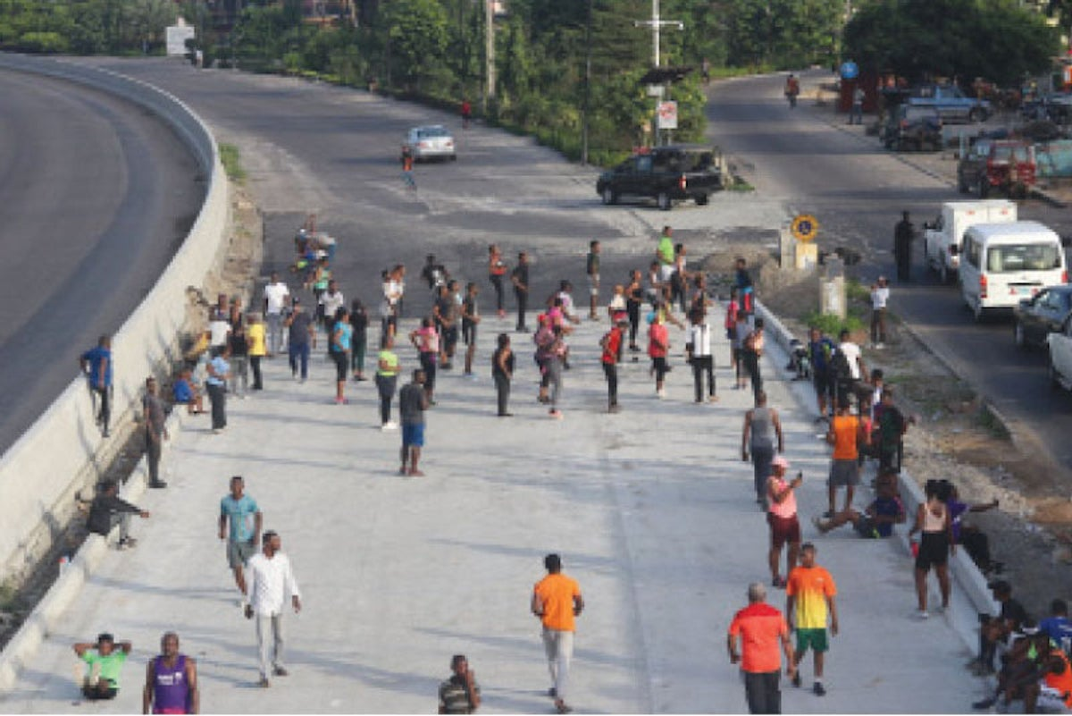 FILE PHOTO: Joggers on the highway