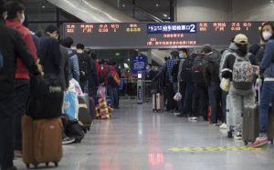 Wuhan residents free to go, China lifts travel ban
