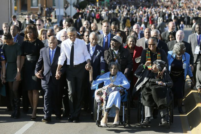 President Barack Obama in a march with civil rights movement veterans across the Edmund Pettus Bridge in Selma, Ala., March 7, 2015. On Obama's right are Rep. John Lewis and first lady Michelle Obama. (Jonathan Ernst/Reuters)