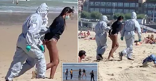 The woman dragged off the beach by officials