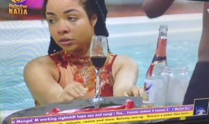 Life continues! Nengi spotted sipping wine and swimming excitedly shortly after crying over Ozo's eviction (Video)
