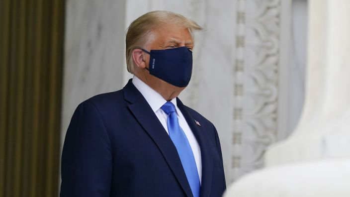 President Trump wears a protective mask while paying respects to late Supreme Court Justice Ruth Bader Ginsburg outside the Supreme Court in Washington, D.C., on Thursday. (Alex Brandon/AP Photo/Bloomberg via Getty Images)
