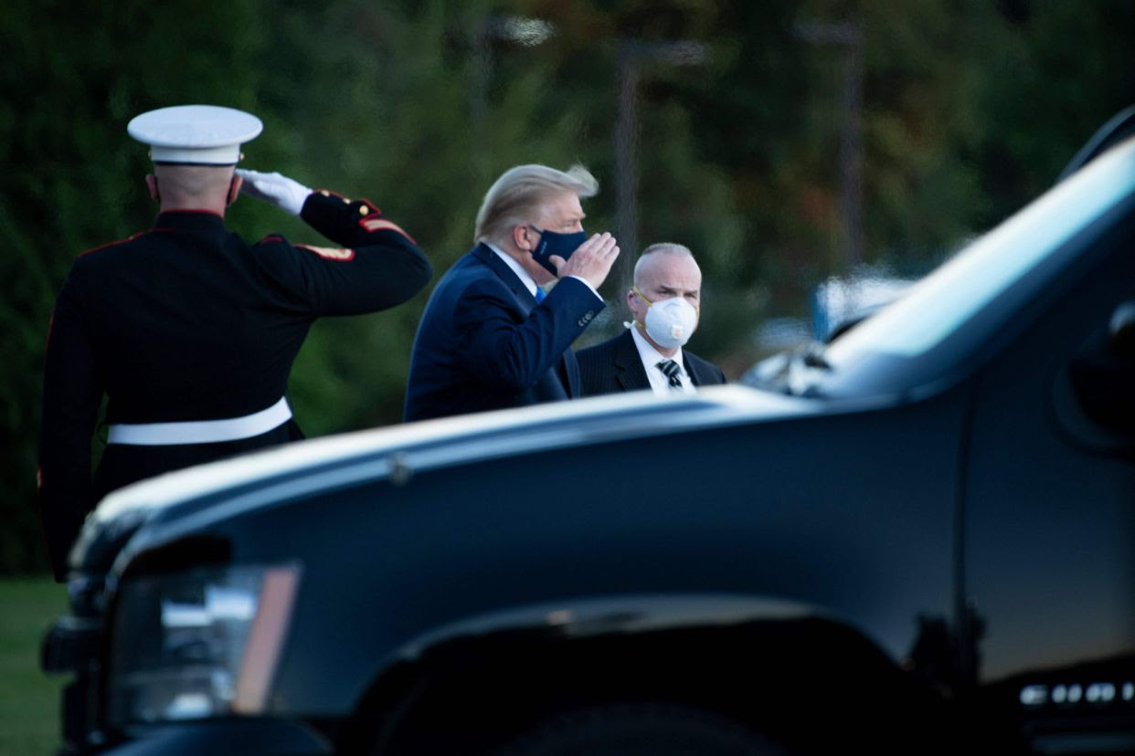 President Donald Trump walks off Marine One while arriving at Walter Reed Medical Center in Bethesda, Maryland on October 2, 2020.