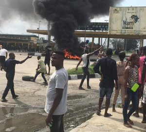PHOTOS: #ENDSARS protesters chant anti-govt songs in Warri