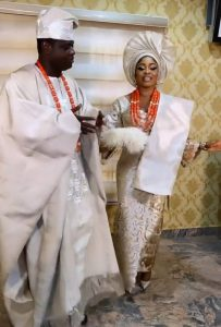 Malivelihood gifts his wife, Deola Smart a Porsche Cayenne at their traditional wedding.