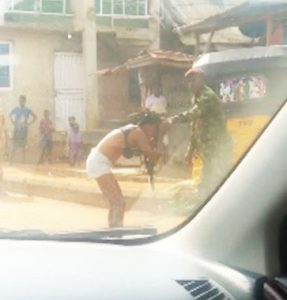 Soldier beats and strips lady naked for indecent dressing in Ogun (video)