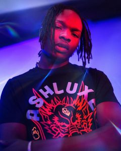 Naira Marley reacts as Cameroonian lady tattooed his name on her chest