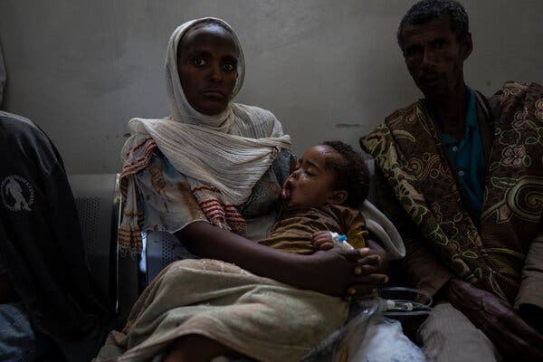 Mebrihit Gebriel with her niece at a hospital in Mekelle in the Tigray region of Ethiopia in March. Aid workers say 5.2 million people urgently need relief aid in Tigray.