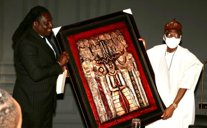 The President of the Association of Advertising Agencies of Nigeria (AAAN), Mr. Steve Babaeko (left), presenting a souvenir to the Minister of Information and Culture, Alhaji Lai Mohammed, during the meeting of AAAN and the Minister in Lagos on Friday