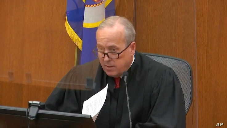 In this image taken from video, Hennepin County Judge PeterCahill presides over the sentencing of former Minneapolis police…