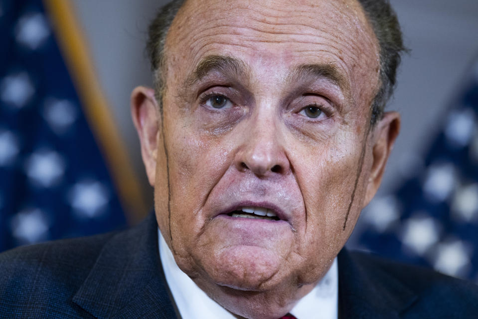 Rudy Giuliani speaks at a news conference in November 2020 at the Republican National Committee about lawsuits contesting the outcome of the 2020 presidential election.